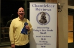 John Trudel proudly accepts his First in category Paranormal award.